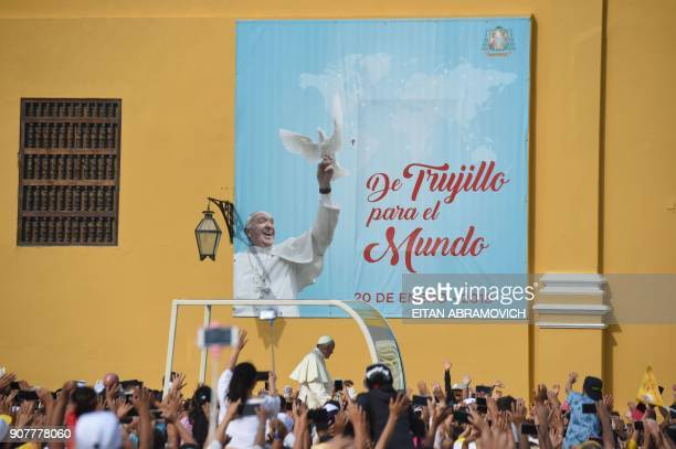Pope Francis greets the crowd as he passes in the popemobile through the streets of the Peruvian city of Trujillo on January 20 2018 Pope Francis...