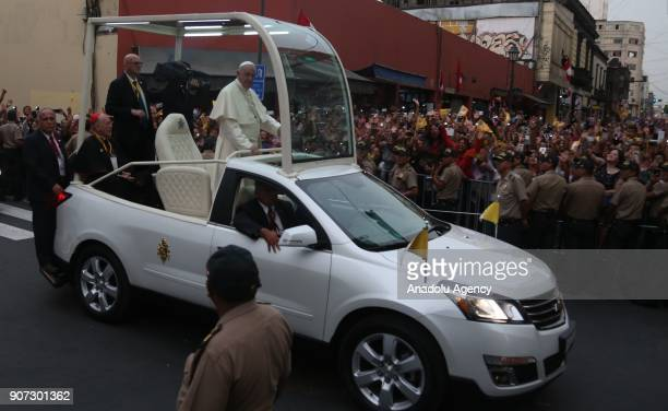 Pope Francis greets the crowd during his departure from the Government Palace after his meeting with Peruvian President Pedro Pablo Kuczynski in Peru...