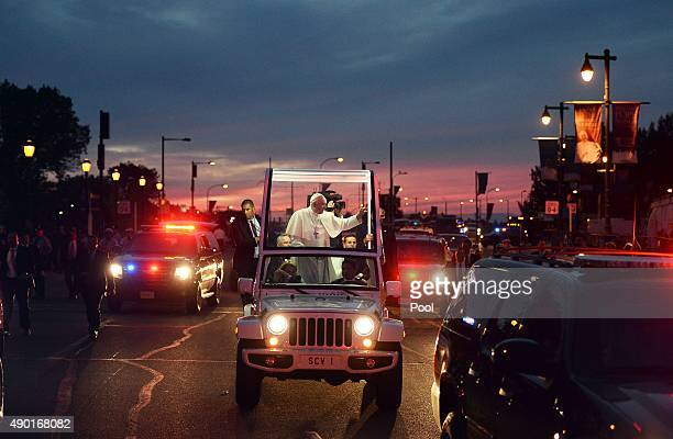 Pope Francis greets the crowd en route to the Festival of Families on September 26 2015 in Philadelphia Pennsylvania Pope Francis wraps up his trip...