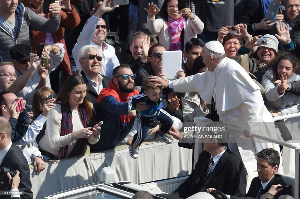 Pope Francis greets the crowd from the popemobile after the Easter Sunday mass on March 27, 2016 at St Peter's square in Vatican. Christians around the world are marking the Holy Week, commemorating the crucifixion of Jesus Christ, leading up to his resurrection on Easter.