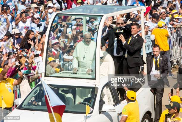 Pope Francis greets the faithful as he arrives to Huanchaco during his 4day apostolic visit to Peru on January 20 2018 in Huanchaco Peru