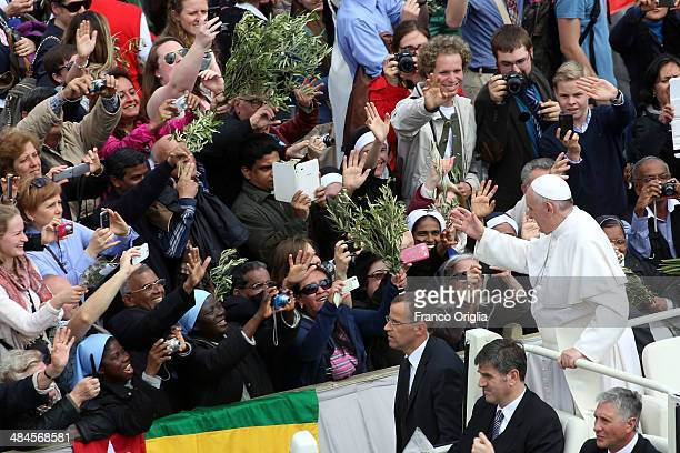 Pope Francis greets the faithful as he attends Palm Sunday Mass at St Peter's Square on April 13 2014 in Vatican City Vatican Palm Sunday which is...