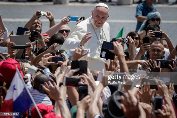Pope Francis greets the faithful as he leaves at the end of a Holy Mass marking the Pentacost holiday in St. Peter's Square in Vatican City, Vatican...