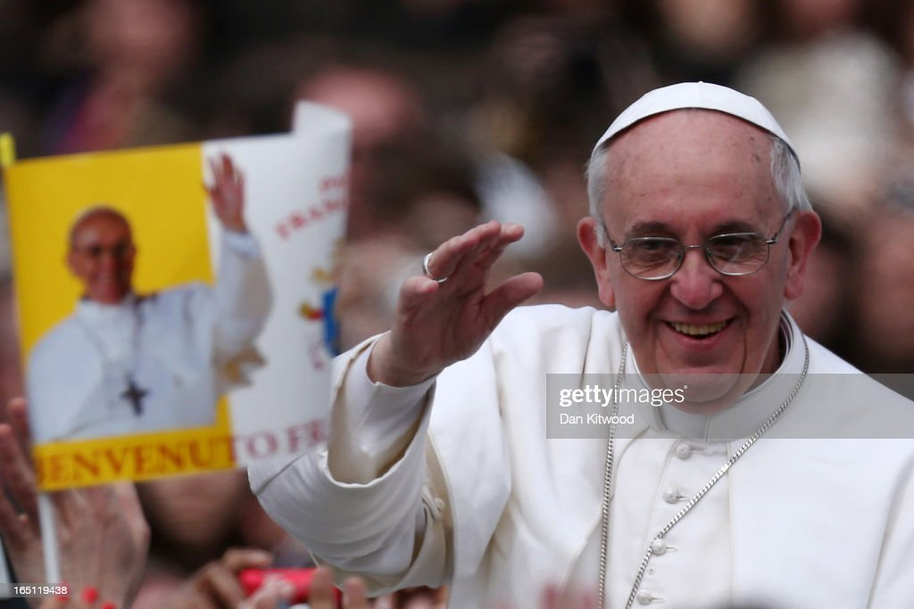 Pope Francis greets the faithful prior to his first 'Urbi et Orbi' blessing from the balcony of St. Peter's Basilica during Easter Mass on March 31, 2013 in Vatican City, Vatican. Pope Francis delivered his message to the gathered faithful from the central balcony of St. Peter's Basilica in St. Peter's Square after his first Holy week as Pontiff.