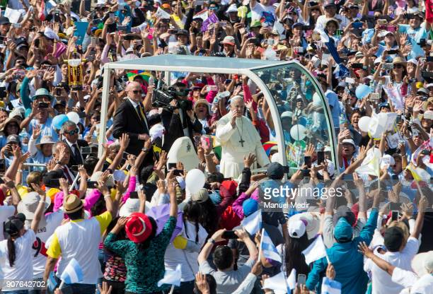 Pope Francis greets the faithfull as he arrives to Huanchaco during his 4day apostolic visit to Peru on January 20 2018 in Huanchaco Peru
