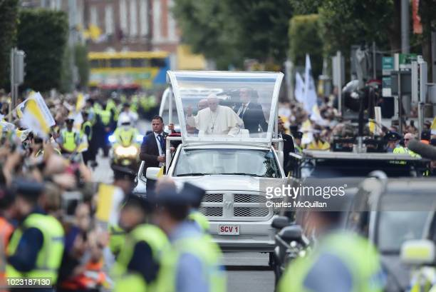 Pope Francis greets the public as he travels through the city in the Popemobile on August 25, 2018 in Dublin, Ireland. Pope Francis is the 266th...