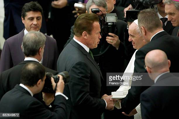 Pope Francis greets US actor and former governor of California Arnold Schwarzenegger during his weekly audience at the Paul VI Hall on January 25...