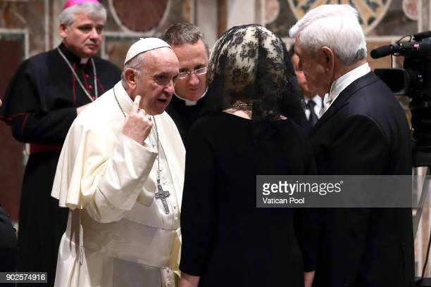 Pope Francis greets Us ambassador to the Holy See Callista Gingrich and her husband Newt Gingrich during the State Of The World Address to accredited...