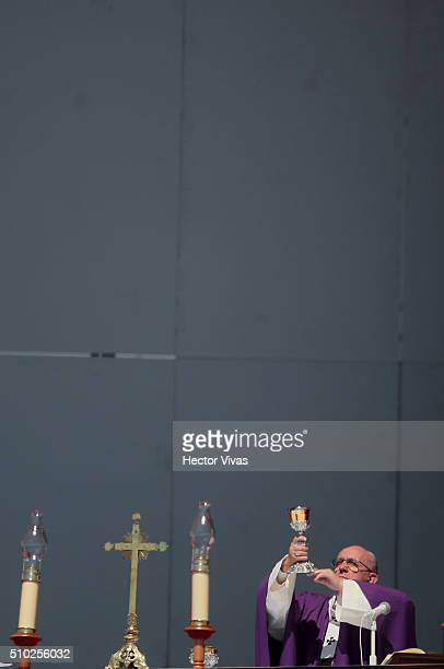 Pope Francis hands the chalice during a mass for the people at El Caracol on February 14, 2016 in Ecatepec, Mexico. Pope Francis is on a five days...