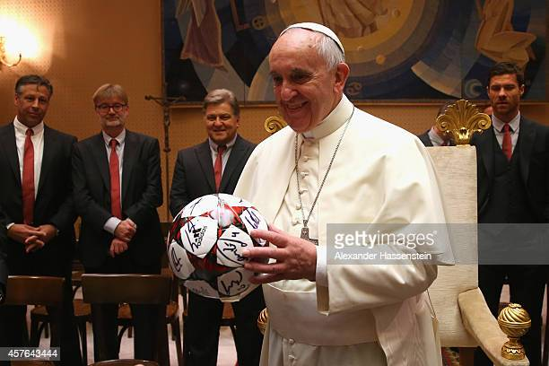 Pope Francis holds a gift of FC Bayern Muenchen during an private audience with the team of FC Bayern Muenchen in the Palace of the Vatican on...