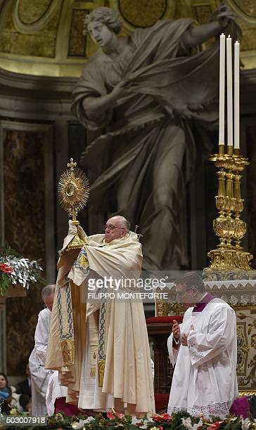 Pope Francis holds a monstrance during the New Year's Vespers at St Peter's basilica on December 31 2015 at the Vatican AFP PHOTO / FILIPPO...