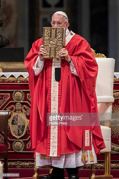 S BASILICA VATICAN CITY VATICAN Pope Francis holds the book of the Gospels as he celebrates the Holy Mass with the imposition of the Pallium upon the...