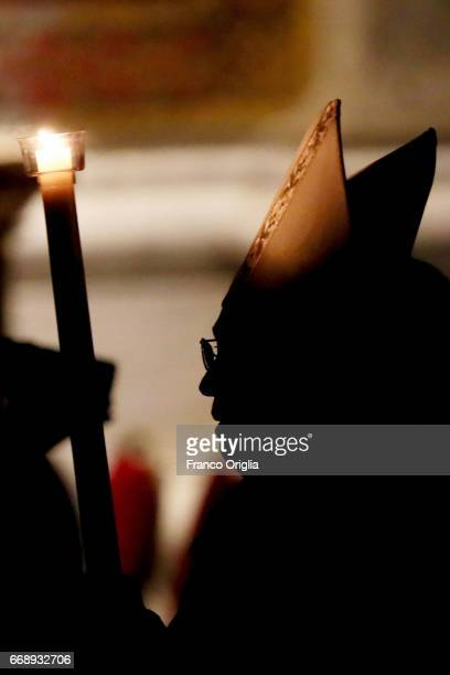 Pope Francis holds the Paschal candle as he arrives at St Peter's Basilica for the Easter vigil mass on April 15 2017 in Vatican City Vatican Pope...