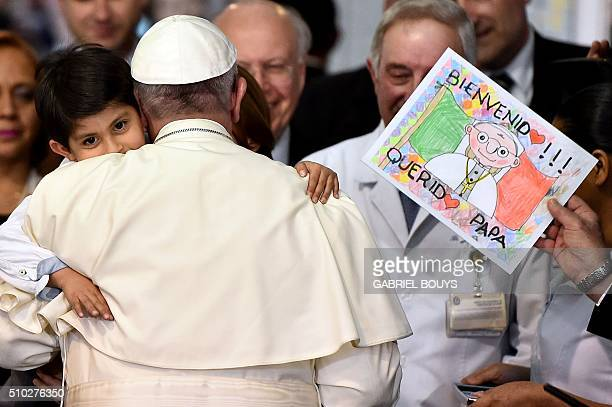Pope Francis hugs a child during his visit to the Federico Gómez children's hospital in Mexico on February 14 2016 Pope Francis celebrated an openair...