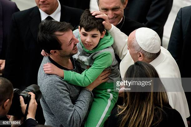 Pope Francis hugs a child during his weekly general audience in the Paul VI Hall at the Vatican Wednesday Nov 30 2016 During the winter months the...