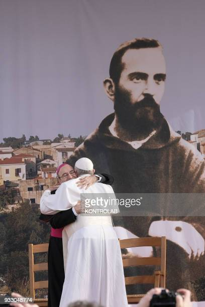 PIETRELCINA CAMPANIA ITALY Pope Francis hugs Archbishop of Benevento Felice Accrocca during his visit in the birthplace of Padre Pio the famous Saint...