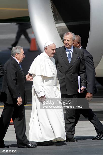Pope Francis is being welcomed by Cuba's president Raul Castro upon his arrival in Cuba, on February 12 in Havana, Cuba. Pope Francis met with...