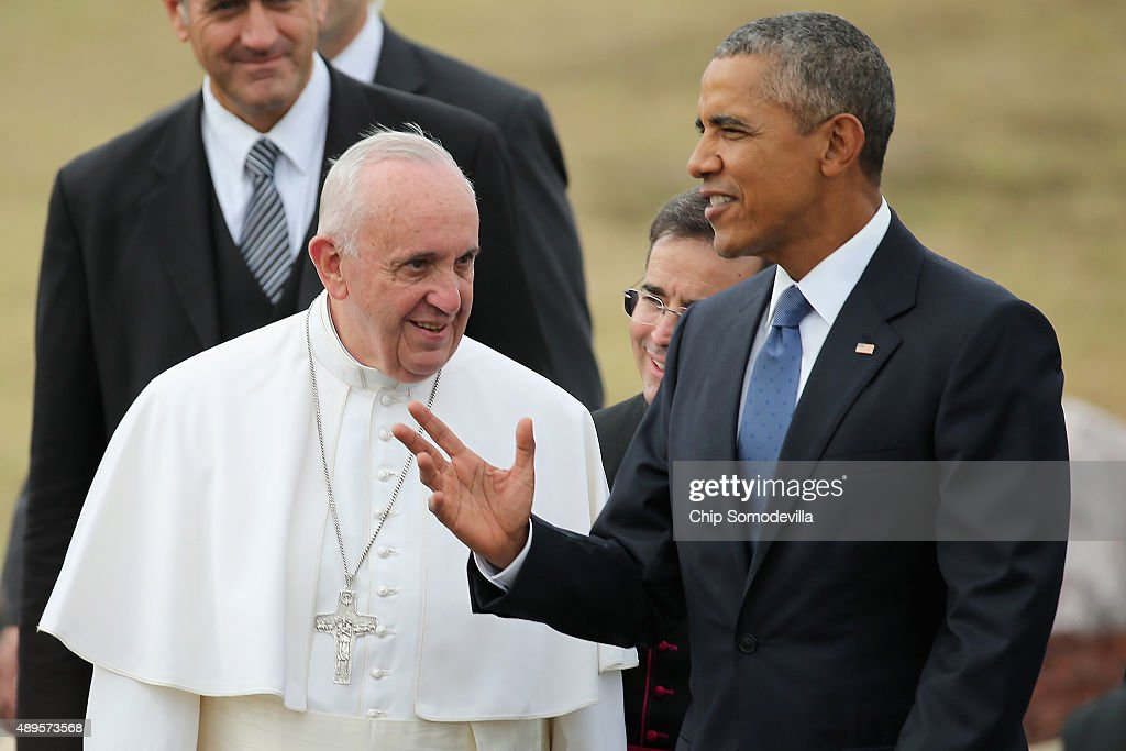 Pope Francis is escorted by U.S. President Barack Obama (R) after arriving from Cuba September 22, 2015 at Joint Base Andrews, Maryland. Francis will be visiting Washington, New York City and Philadelphia during his first trip to the United States as Pope.