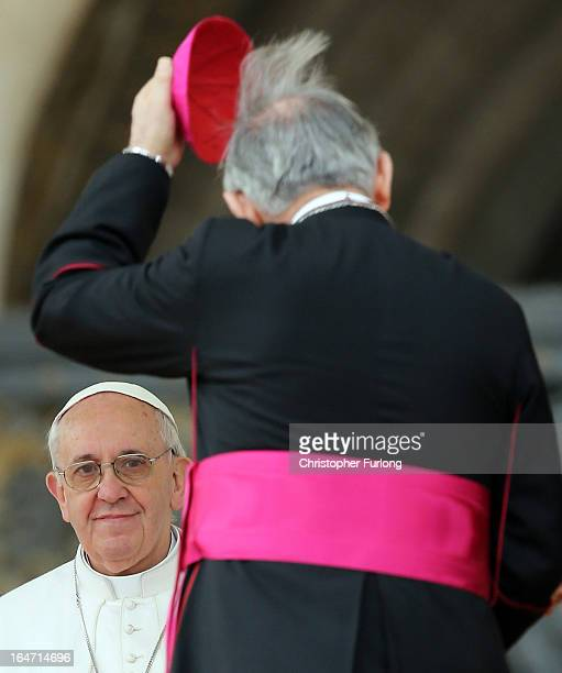 Pope Francis is greeted by a bishop during his first weekly general audience as pope on March 27 2013 in Vatican City Vatican Pope Francis held his...