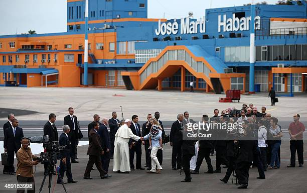 Pope Francis is greeted by a woman and child as he arrives at Jose Marti International Airport on September 19, 2015 in Havana, Cuba. Pope Francis is...