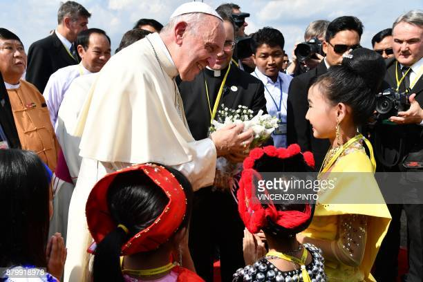 Pope Francis is greeted by children upon his arrival at Yangon International Airport on November 27 2017 Pope Francis arrived in Myanmar on November...