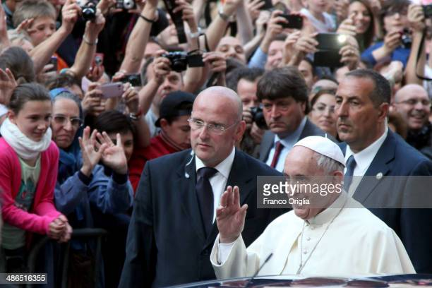 Pope Francis is greeted by crowds as he visits the Jesuit church of St Ignatius of Loyola for a thanking ceremony after the canonization of Brazilian...