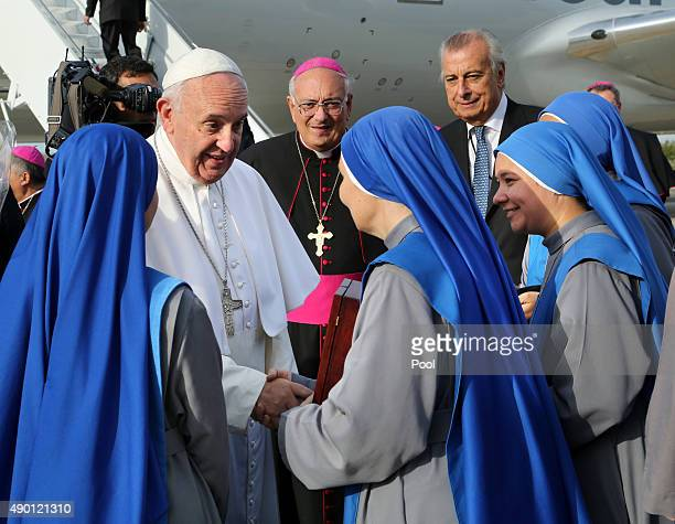Pope Francis is greeted by nuns from the Monastery of the Precious Blood in Brooklyn NY who presented the pontiff with a gift of flowers as Bishop...