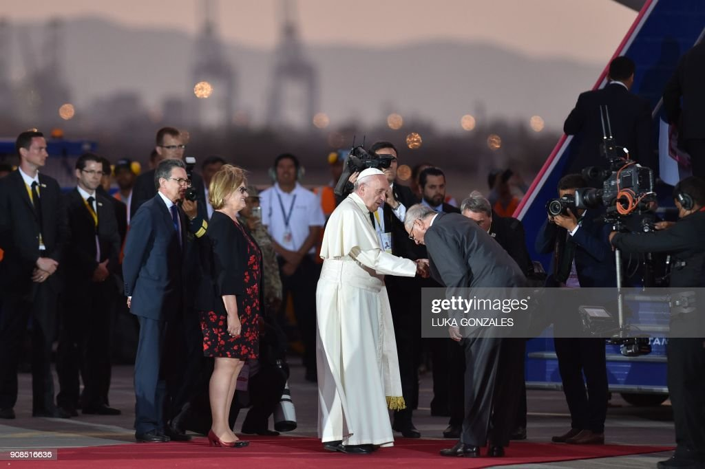 Pope Francis is greeted by Peru's President Pedro Pablo Kuczynski (R) before boarding the plane back to Rome, at Lima's airport on January 21, 2018. Pope Francis took a tough stand against political corruption on Sunday, hours before wrapping up his Latin American trip with a mass at an air base before a million faithful. /