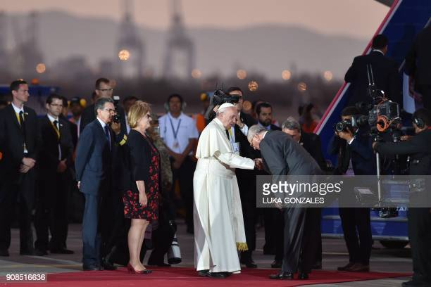 Pope Francis is greeted by Peru's President Pedro Pablo Kuczynski before boarding the plane back to Rome at Lima's airport on January 21 2018 Pope...