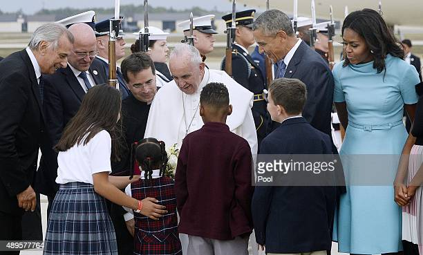 Pope Francis is greeted by US President Barack Obama first lady Michelle Obama and invited guests after the pontiff's arrival from Cuba September 22...