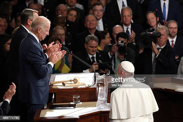 Pope Francis is greeted by Vice President Joe Biden and Speaker of the House John Boehner as he arrives to speak during a joint meeting of the US...