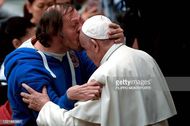 Pope Francis is kissed by a person during the general audience at the Paul VI Audience Hall at the Vatican on February 19 2020