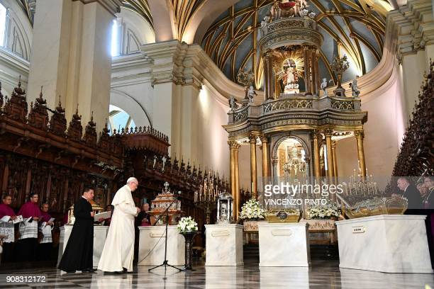 Pope Francis is pictured during a prayer before the relics of the four Peruvian saints at Lima's Cathedral on January 21 2018 Francis will pray the...