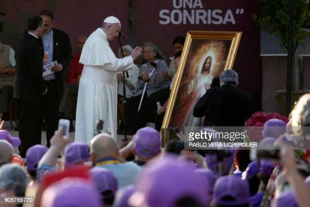 Pope Francis is pictured next to an image of Jesus Christ during his visit at Padre Hurtado Sanctuary in Santiago on January 16 2018 The pope landed...