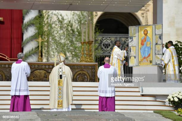 Pope Francis is seen before he addresses the crowd for his traditional 'Urbi et Orbi' Blessing to the City of Rome and to the World from the central...