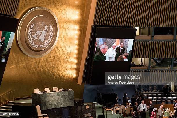 Pope Francis is shown on the screen as he enters the United Nations on September 25 2015 at United Nations Headquarters in New York City The Pope is...
