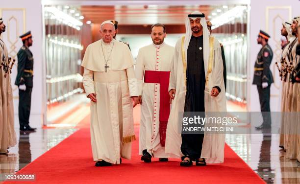 Pope Francis is welcomed by Abu Dhabi's Crown Prince Sheikh Mohammed bin Zayed alNahyan upon his arrival at Abu Dhabi International Airport in the...