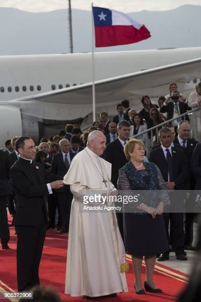 Pope Francis is welcomed by Chilean President Michelle Bachelet upon his arrival at the Comodoro Arturo Merino Benitez International Airport as part...