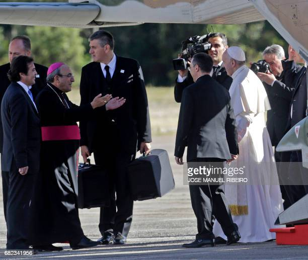 Pope Francis is welcomed by Portuguese Bishop Antonio Marto upon his arrival at Fatima's Sanctuary in Fatima central Portugal on May 12 2017 Two of...