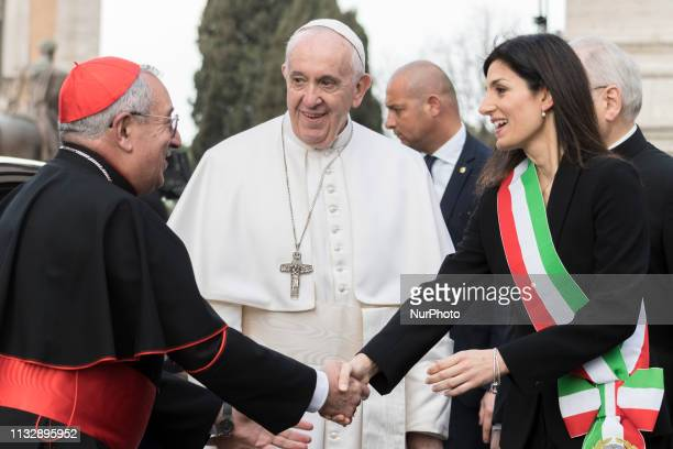 Pope Francis is welcomed by Rome's mayor Virginia Raggi during his visit to the Rome's city hall Tuesday March 26 2019