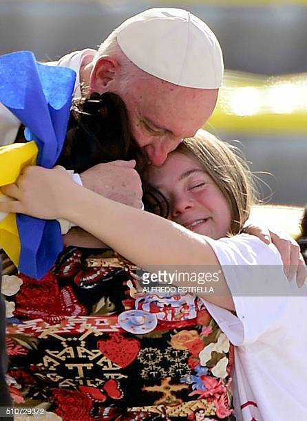 Pope Francis is welcomed by two young faithful during his arrival at the Morelos stadium in Morelia Michoacan State Mexico on February 16 2016 Pope...