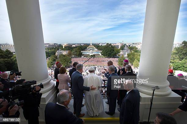 Pope Francis is welcomed to the Speakers Balcony at the US Capitol by members of congress September 24 2015 in Washington DC Pope Francis will be the...