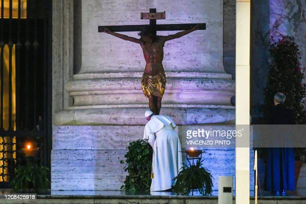 Pope Francis kisses a miraculous crucifix that in 1552 was carried in a procession around Rome to stop the great plague that was brought from the San...
