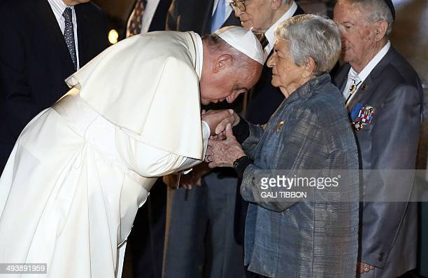 Pope Francis kisses the hand of holocaust survivor Sonia TunikGeron during his visit to the Yad Vashem Holocaust Memorial museum in Jerusalem...