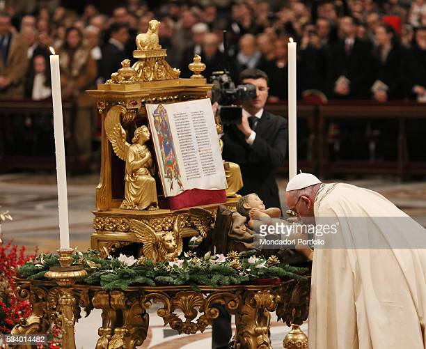 Pope Francis kissing the statuette of the Child Jesus while celebrating the First Vespers and the Te Deum to give thanks for the year at Saint...