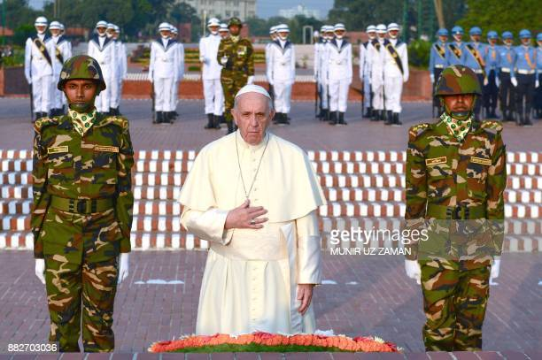 Pope Francis lays a floral wreath at the National Martyrs' memorial of Bangladesh in Savar some 30 km from Dhaka on November 30 2017 Pope Francis...