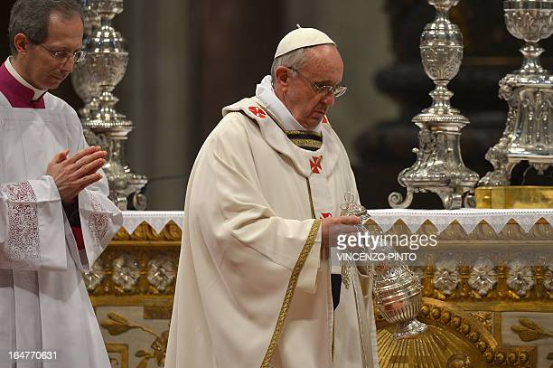 Pope Francis leads the Chrism mass on holy thursday on March 28 2013 at the St Peter basilica at the Vatican AFP PHOTO / VINCENZO PINTO