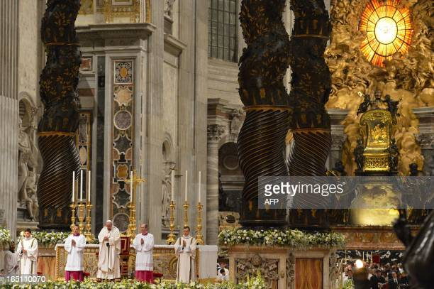 Pope Francis leads the Easter Vigil on Holy Saturday at the St Peter's basilica on March 30 2013 at the Vatican Easter Vigil also called the Paschal...