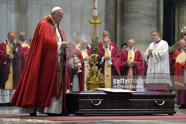 Pope Francis leads the funeral of Cardinal Roberto Tucci at St Peter's basilica on April 17 2015 in Vatican AFP PHOTO / ANDREAS SOLARO