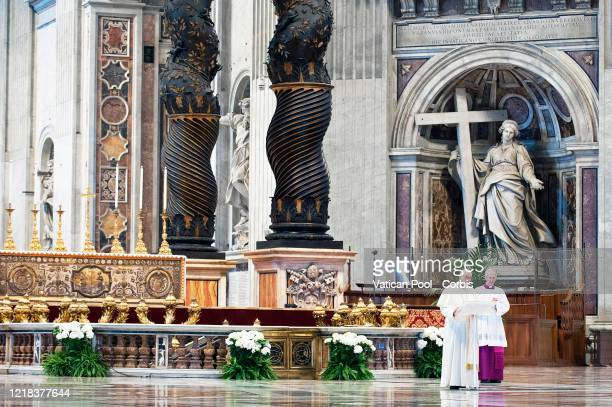 Pope Francis leads the solemn Easter Mass behind closed doors at St Peter's Basilica on April 12 2020 in Vatican City Vatican Following the...